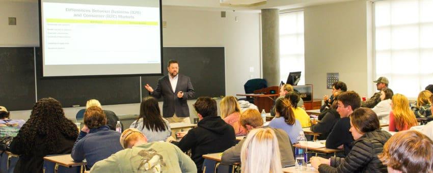 Dr. Matt Shaner teaches marketing to a classroom of marketing students